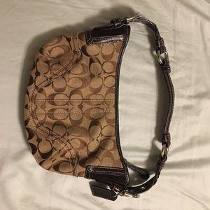 Brown Coach signature hobo bag